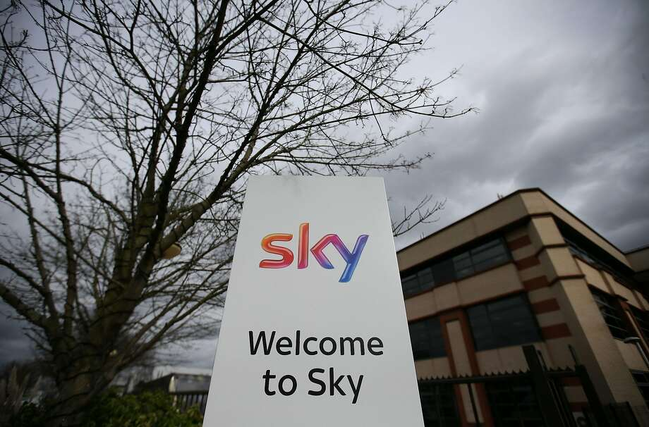 (FILES) In this file photo taken on March 17, 2017 A Sky logo is pictured on a sign next to the entrance to pay-TV giant Sky Plc's headquarters in Isleworth, west London on March 17, 2017. US cable giant Comcast on February 27, 2018 said it has offered more than £22 billion ($31 billion, 25 billion euros) to buy pan-European satellite TV group Sky.  Comcast is offering more per share compared with a bid from Rupert Murdoch's 21st Century Fox for the 61 percent of Sky it does not yet own, according to details of the surprise announcement.  / AFP PHOTO / Daniel LEAL-OLIVASDANIEL LEAL-OLIVAS/AFP/Getty Images Photo: DANIEL LEAL-OLIVAS, AFP/Getty Images