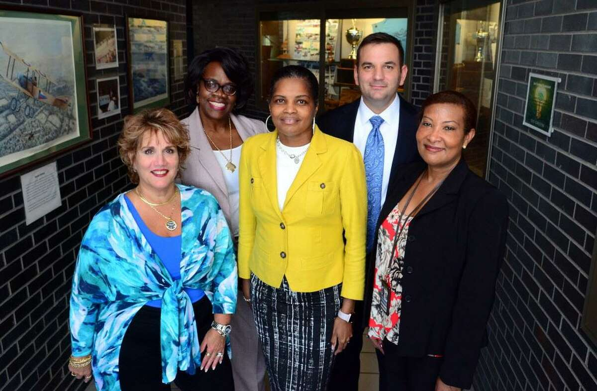 Bridgeport Superintendent of Schools Dr. Aresta Johnson, center, stands with her newly hire assistant superintendents at the Bridgeport Regional Vocational Aquaculture Center in Bridgeport, Conn., on Wednesday Sept. 7, 2017. Standing around Dr. Johnson from left to right is Deborah Santacapita, Jamey Brown Clayton, John Lischner and Christina Otuwa.