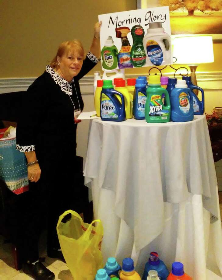 Members of the Woman's Club of Danbury and New Fairfield had a busy January. Members visited several organizations in the Greater New Milford area to deliver a variety of donations. Old phones were delivered to the Danbury Women's Center, reams of computer paper were donated to Volunteers Income Tax Assistant, birthday bags were organized for the Danbury Women's Center and laundry soaps, toiletries and shopping bags - that will be used to assist needy families through the Dorothy Day Program - were donated to the Market Place on West Street in Danbury. In addition, WCDNF T-shirt sales are supporting a beautification project at a local nursing home. Above, New Milford resident Karla Ryerson delivers the donations to the Market Place. Photo: Courtesy Of Woman's Club Of Danbury And New Fairfield / The News-Times Contributed