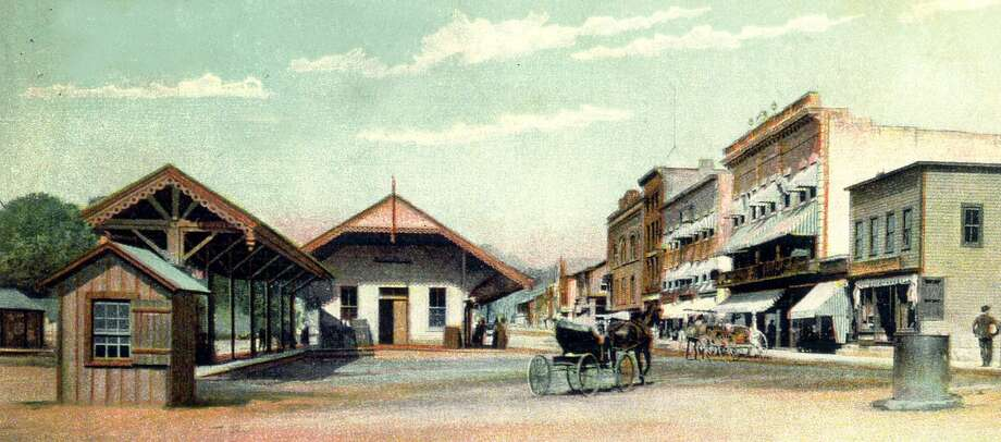 "Thousands of motorists drive through the intersection Bridge and Railroad streets in New Milford on a daily basis. Traffic was much less busy in the late 1800s, shown above in this photograph which looks north on Railroad Street. To the left is the railroad station and prominent to the right is the Young's Hotel. If you have a photograph you'd like to share for ""Way Back When,"" contact Deborah Rose at drose@newstimes.com or 860-355-7324. Photo: Contributed Photo / Contributed Photo / The News-Times Contributed"