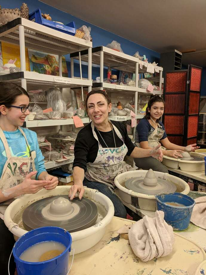The Village Center for the Arts in New Milford regularly offers a variety of workshops, camps and special events for children, teens and adults. In addition, the 10 Main St. non-profit art center offers parties for birthdays and other special occasions. Above, VCA Executive Director Sharon Kaufman, center, is joined by Sophia Spinetti, left, and Sabrina Maia as they work on a pottery project. Photo: Courtesy Of The Village Center For The Arts / The News-Times Contributed