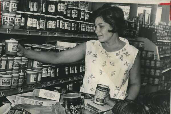 Sept. 9, 1965Grocery lists had extra items hastily added to them Thursday as housewives stocked up on canned goods and other nonperishable foods in case Hurricane Betsy hits this area. Mrs. A. R. Sanchez, 2603 W. Dallas, got help from daughters Sandy, rear, and Debbie as she shopped at a downtown supermarket. Included in her purchases were more canned goods, large cans of coffee, and spreads for sandwiches, including lots of peanut butter.