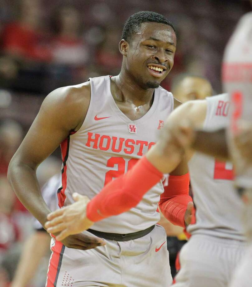 The University of Houston Gabe Grant celebrates one of his three points shots with teammate Galen Robinson Jr. during the second half of basketball game against East Carolina University at Texas Southern University Sunday, Feb. 25, 2018, in Houston. ( Melissa Phillip / Houston Chronicle ) Photo: Melissa Phillip, Staff / © 2018 Houston Chronicle