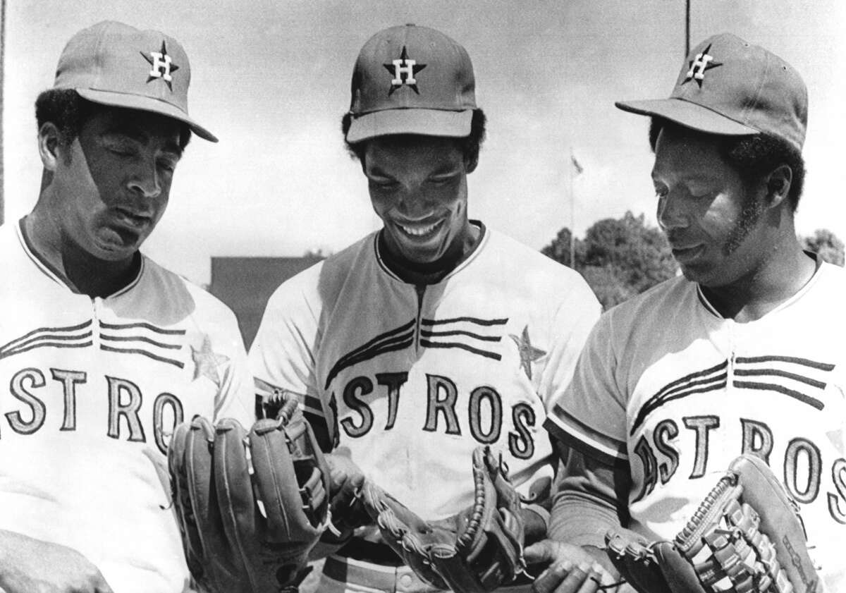 COCOA, FL - MARCH 31: Outfielders Tommie Agee #20, Cesar Cedeno #28 and Jim Wynn #24 of the Houston Astros look at their gloves during spring training on March 31, 1973 in Cocoa, Florida. (Photo by B Bennett/Getty Images)