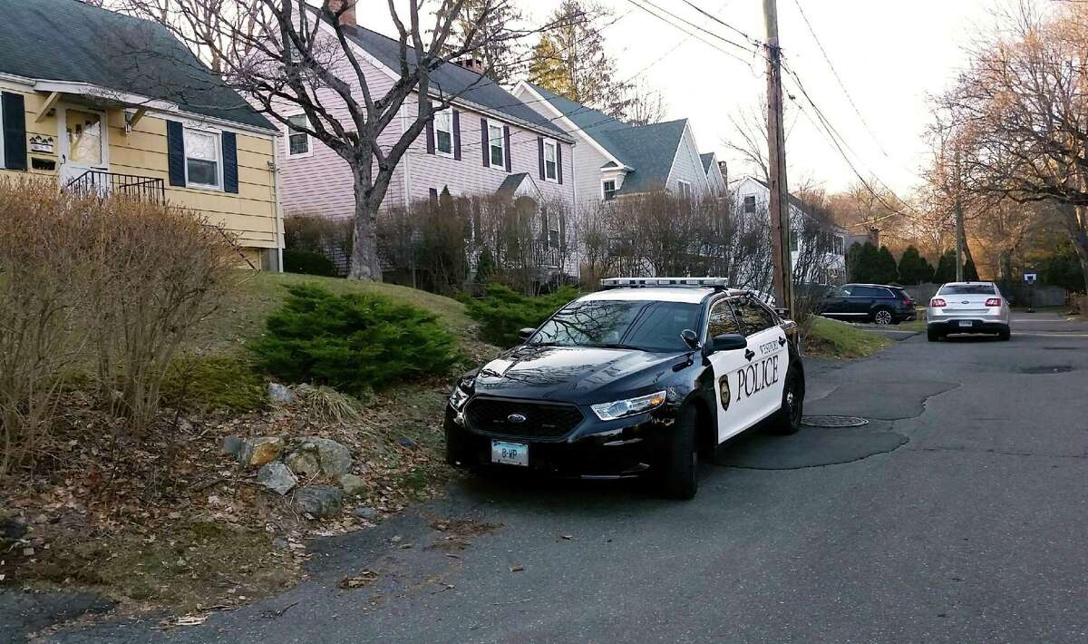 Westport and state police cars sit outside a Westport house believed to be part of an ongoing investigation into deadly school threats on Tuesday, Feb. 27, 2018.