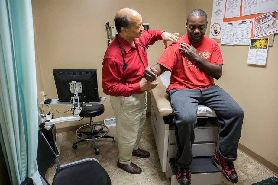 Dr. James Jackson, MD, examines Matthew Shorter, 51, a medicaid patient enrolled in the Healthy Indiana Plan (HIP), at the Heart City Health Center  on Thursday, June 4, 2015 in Elkhart, Ind. (Zbigniew Bzdak/Chicago Tribune/TNS) Photo: Zbigniew Bzdak/TNS