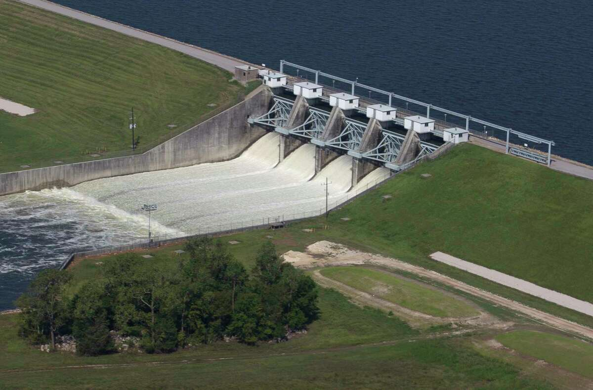 The Conroe Dam releases water from Lake Conroe, Thursday, Aug. 31, 2017, in Conroe.