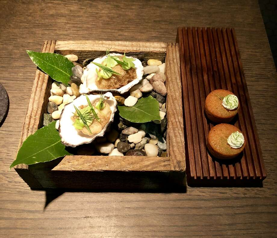 Opening items on the Commis menu: oysters with buckwheat and bay laurel and caramelized onion financier. Photo: Michael Bauer, The Chronicle