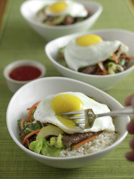 Bibimbap is a Korean dish of mixed vegetables and meat over rice with hot sauce. Photo: Courtesy Ben Fink, The Culinary Institute Of America / © 2006 Ben Fink/The Culinary Institute of America