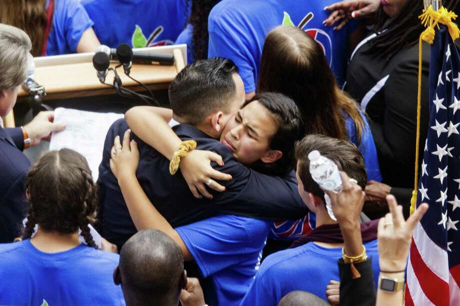 Florida Rep. Carlos Guillermo Smith gets a hug from Victoria Mejai, a sophomore from South Broward High School after he spoke at a rally against gun violence on the steps of the old Florida Capitol in Tallahassee, Fla., Feb 21. The Legislature, however, failed to enact a ban on assault-style rifles, of the kind used in the Parkland massacre. Photo: Mark Wallheiser /Associated Press / FR171224 AP