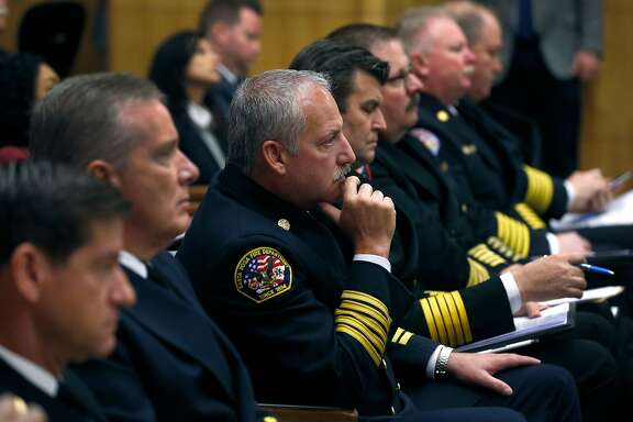 Santa Rosa Fire Chief Tony Gossner sits with other chiefs from around the state before he addresses a joint informational hearing on emergency management and California's fire mutual aid system at the state Capitol in Sacramento, Calif. on Tuesday, Feb. 27, 2018.