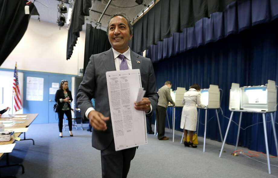 Incumbent Democratic Rep. Ami Bera goes to cast his ballot while voting in Elk Grove, Calif on Nov. 4, 2014. Bera is in a tight race with Republican Doug Ose for the California 7th District seat, one of the most hotly contested congressional seats in the country. Photo: Rich Pedroncelli, Associated Press