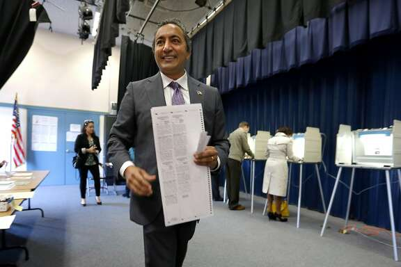 Incumbent Democratic Rep. Ami Bera goes to a cast his ballot while voting in Elk Grove, Calif. Tuesday, Nov. 4, 2014. Bera is in a tight race with Republican Doug Ose for the California 7th District seat, one of the most hotly contested congressional seats in the country (AP Photo/Rich Pedroncelli)