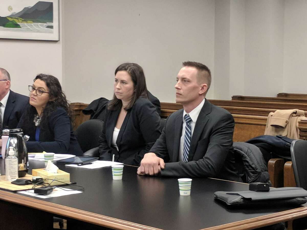 Seattle Police Officer Jason Anderson, right, listens to arguments in King County Superior Court earlier this year during a hearing of his motion to dismiss the lawsuit against himself and officer Steven McNew, for the fatal shooting of Charleena Lyles. The judge declined to dismiss the case. Now an attorney for Lyles' estate accuses Anderson of perjury for his version of events leading up to the shooting.