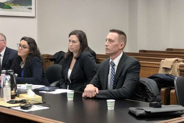 Seattle Police Officer Jason Anderson, right, listens to arguments Friday in King County Superior Court during a hearing of his motion to dismiss the lawsuit against himself and officer Steven McNew, for the fatal shooting of Charleena Lyles.