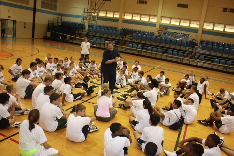 Scott Gernander, the winningest head coach in San Jacinto College's history, talks with his summer campers at Anders Gym towards the end of his tremendous career. Photo: Robert Avery