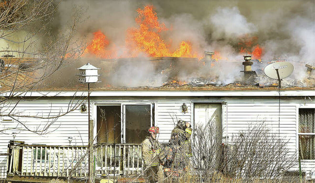 The fire on New Poag Road broke out on the north end of the home, burning through the roof and a wall, but steady winds quickly pushed it through the attic which burned off most of the home's roof.