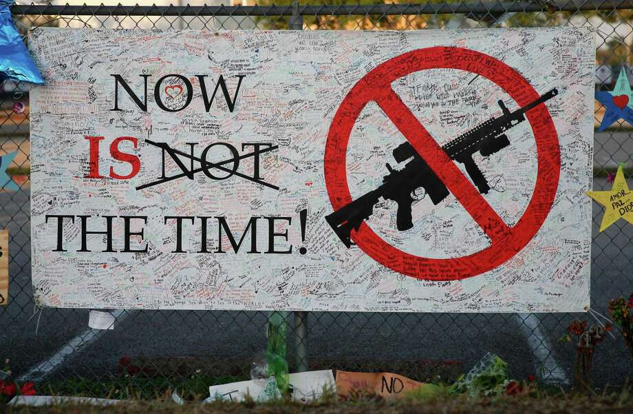 A sign hangs on a fence one at Marjory Stoneman Douglas High School in Parkland, Fla. The school will reopen on Wednesday, two weeks after 17 people were killed in a shooting by former student, Nikolas Cruz. Photo: RHONA WISE / Rhona Wise / AFP/Getty Images / AFP or licensors