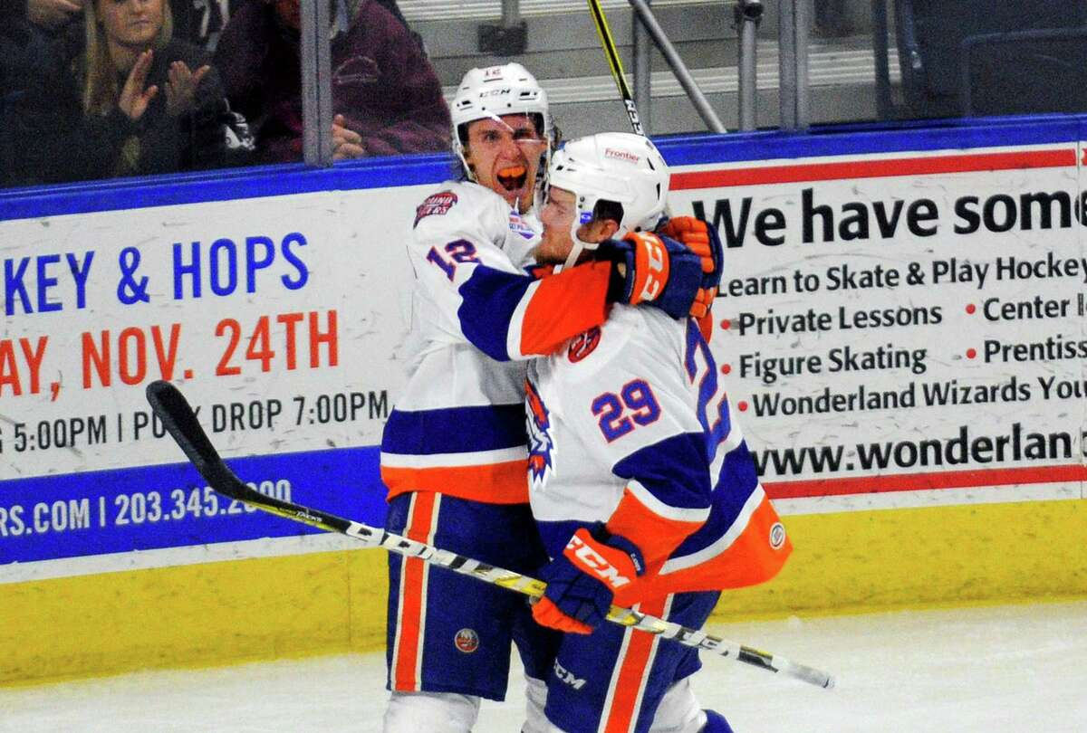 Sound Tigers Josh Holmstrom, left, celebrates a goal with teammate Connor Jones during hockey action against Hartford at the Webster Bank Arena in Bridgeport, Conn., on Friday Nov. 24, 2017. Assisting in the goal along with Jones was Seth Helgeson.