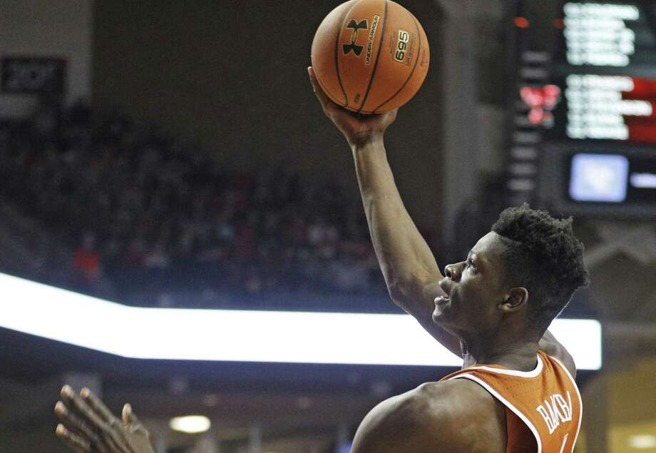 Texas' Mo Bamba (4) lays up the ball during the second half of the team's NCAA college basketball game against Texas Tech, Wednesday, Jan. 31, 2018, in Lubbock, Texas. (AP Photo/Brad Tollefson) Photo: Brad Tollefson, FRE / Associated Press / FR171432 AP