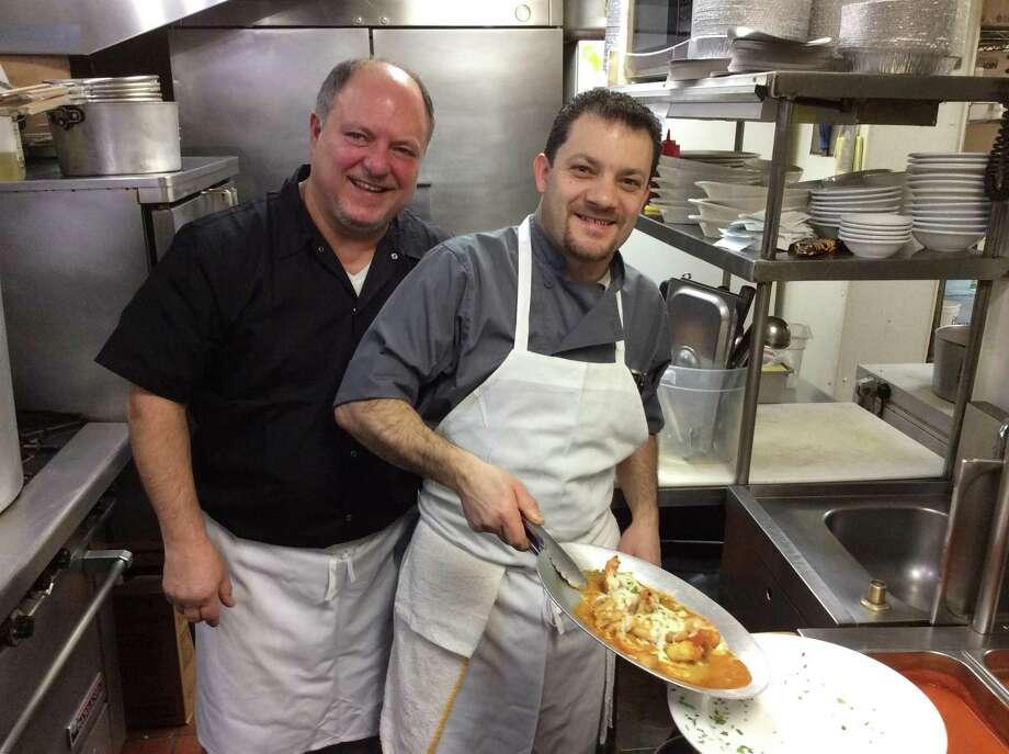 Owner Vincenzo LoMonaco with Chef Atlante plating the Gamberoni Monachina Photo: Stephen Fries / ForHearst Connecticut Media