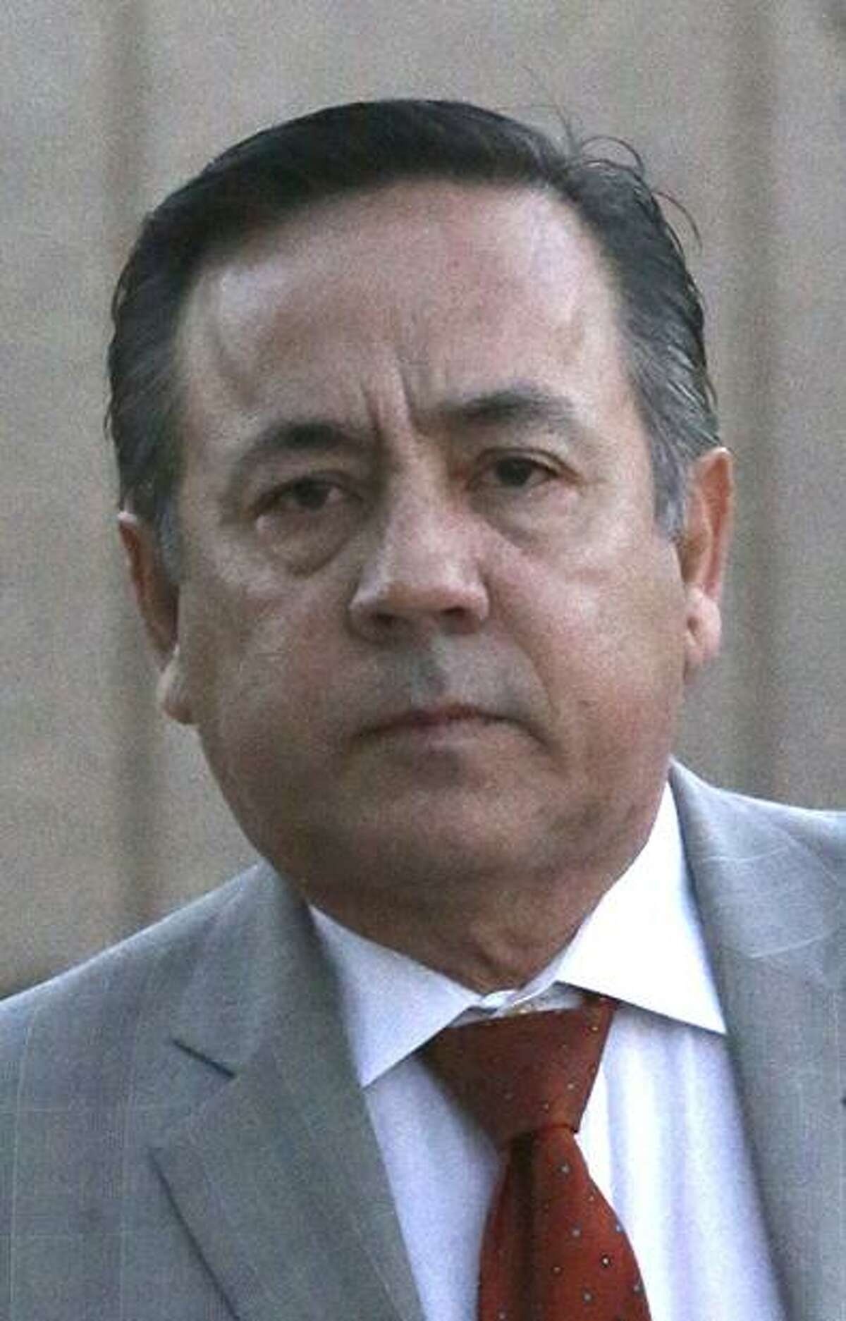 State Senator Carlos Uresti walks Monday morning January 8, 2018 to the John H. Wood, Jr. Federal Courthouse. Uresti is standing trial on charges relating to a bankrupt oil field services company.