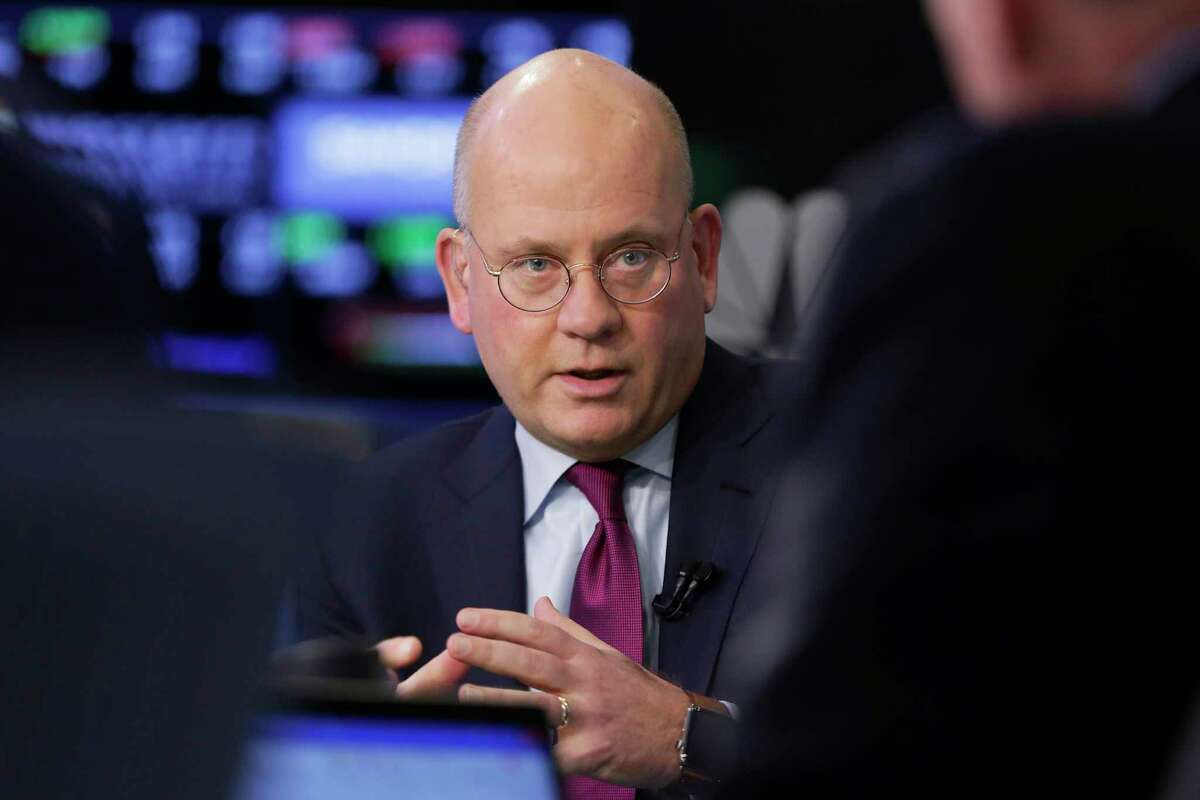 FILE- In this Nov. 14, 2017, file photo, General Electric Chairman and CEO John Flannery is interviewed on the floor of the New York Stock Exchange. Flannery, a longtime insider at GE, was tasked last year with reshaping the company, but the proposed changes at GE have grown more radical over the past several months as negative developments emerge. After cutting the size of its board from 18 to 12 members, General Electric Co. said Monday, Feb. 26, 2018, that a quarter of that board would consist of new members. (AP Photo/Richard Drew, File)