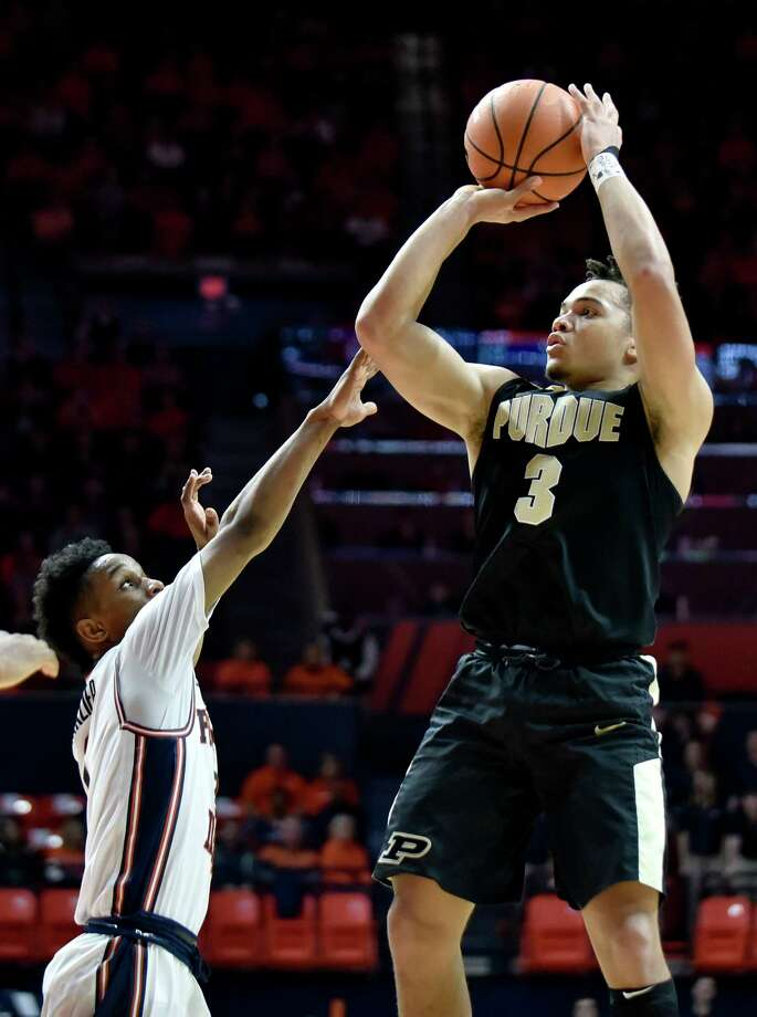 Purdue guard Carsen Edwards (3) shoots over the reach of Illinois guard Trent Frazier during the second half of an NCAA college basketball game in Champaign, Ill., Thursday, Feb. 22, 2018. Purdue won 93-86. (AP Photo/Stephen Haas) Photo: Stephen Haas, Associated Press / FR170194 AP
