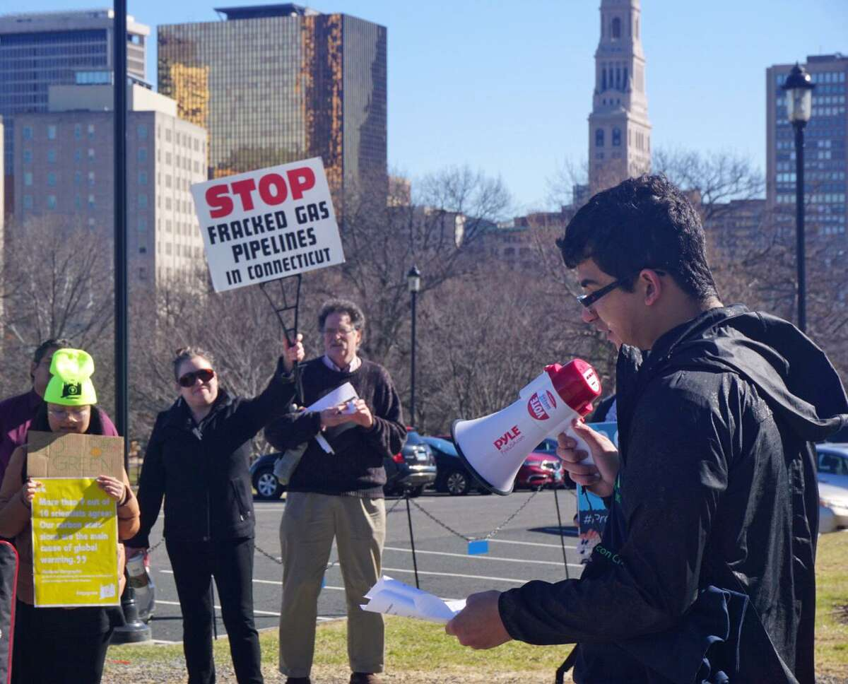 Alex Rodriguez, an organizer with Chispa, a grassroots conservation activism group, spoke to University of Connecticut students and Connecticut Sierra Club members at a rally outside the Capitol in Hartford on Tuesday.