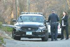 Westport Police Sgt. Jill Ruggiero talks with another officer while investigating the house on Kirock Place after police took a Staples High Shool student into custody Feb. 27.