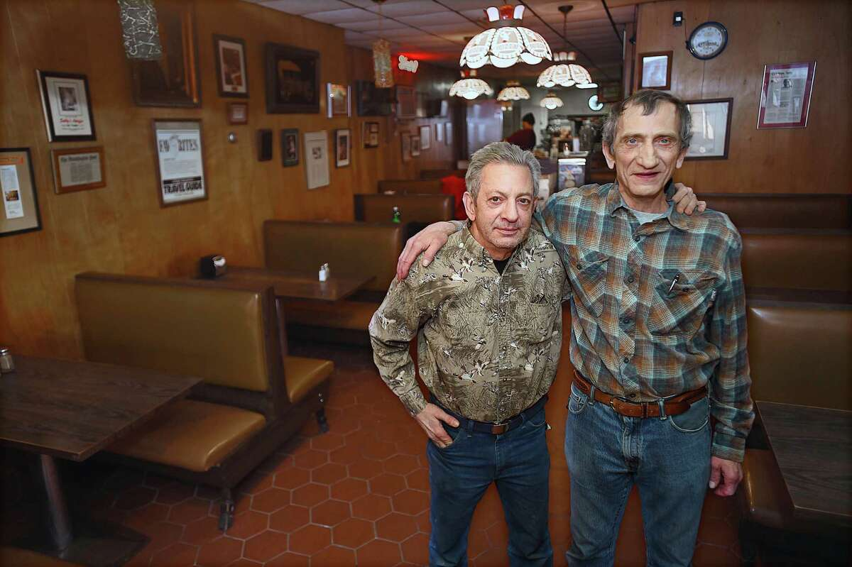 Bobby and Rick Consiglio, former owners and now serving as consultants at Sally's Apizza, Tuesday in the iconic dining room on Wooster Street in New Haven.
