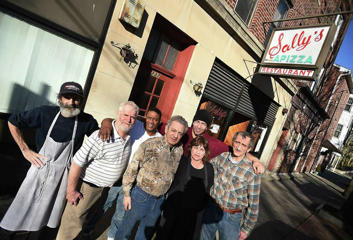 Sally's Apizza staff Brian Baptista, Mike Shanahan, Gilberto Rodrigues Morale, Bobby Consiglio, Angie Diverniero, Enrique Vega and Rick Consiglioat Sally's Apizza on Wooster Street in New Haven Tuesday, ahead of Wednesday's re-opening.