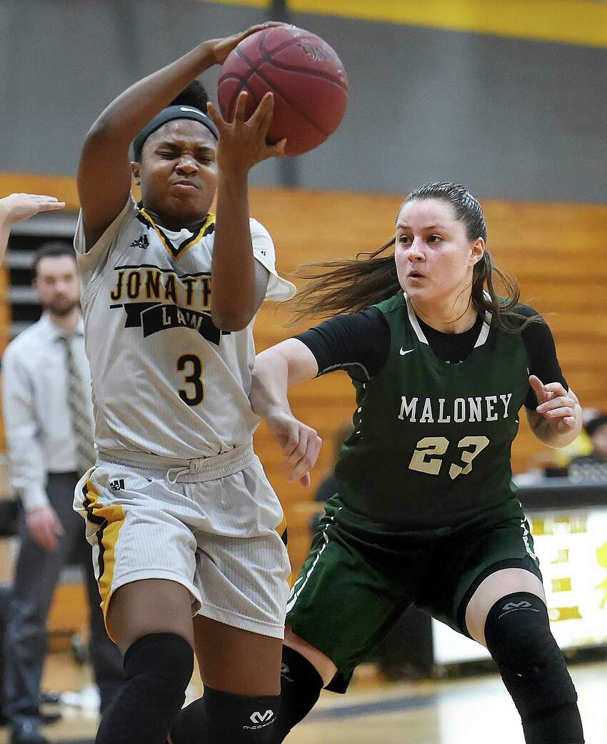 Law junior captain Samara Thacker makes a move on Maloney senior Melanie Polanco, Tuesday, Feb. 27, 2018, in a class L first round matchup of the CIAC state tournament at Jonathan Law High School in Milford. The Lady Lawmen beat Maloney-Meriden, 62-28.