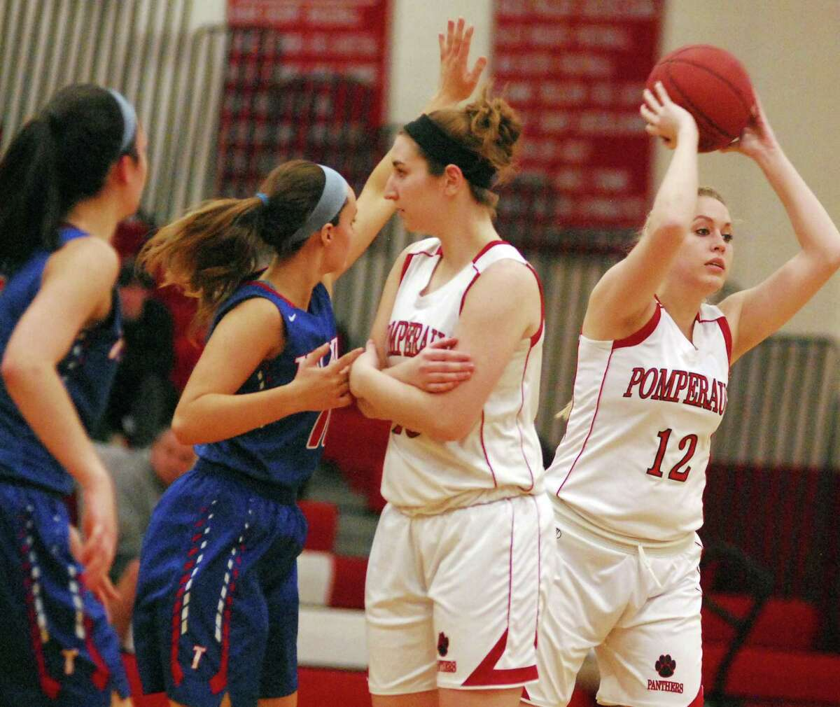 Pomperaug's Megan Todhunter looks to pass during a Class L girls basketball game against Tolland on Tuesday.