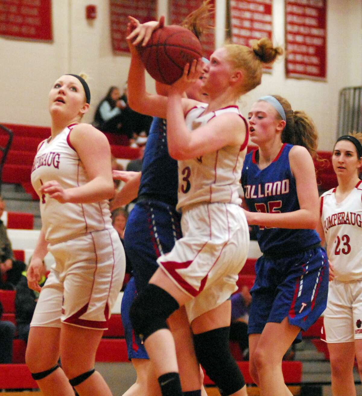 Pomperaug's Maggie Lee drives to the basket during a game against Tolland on Tuesday.