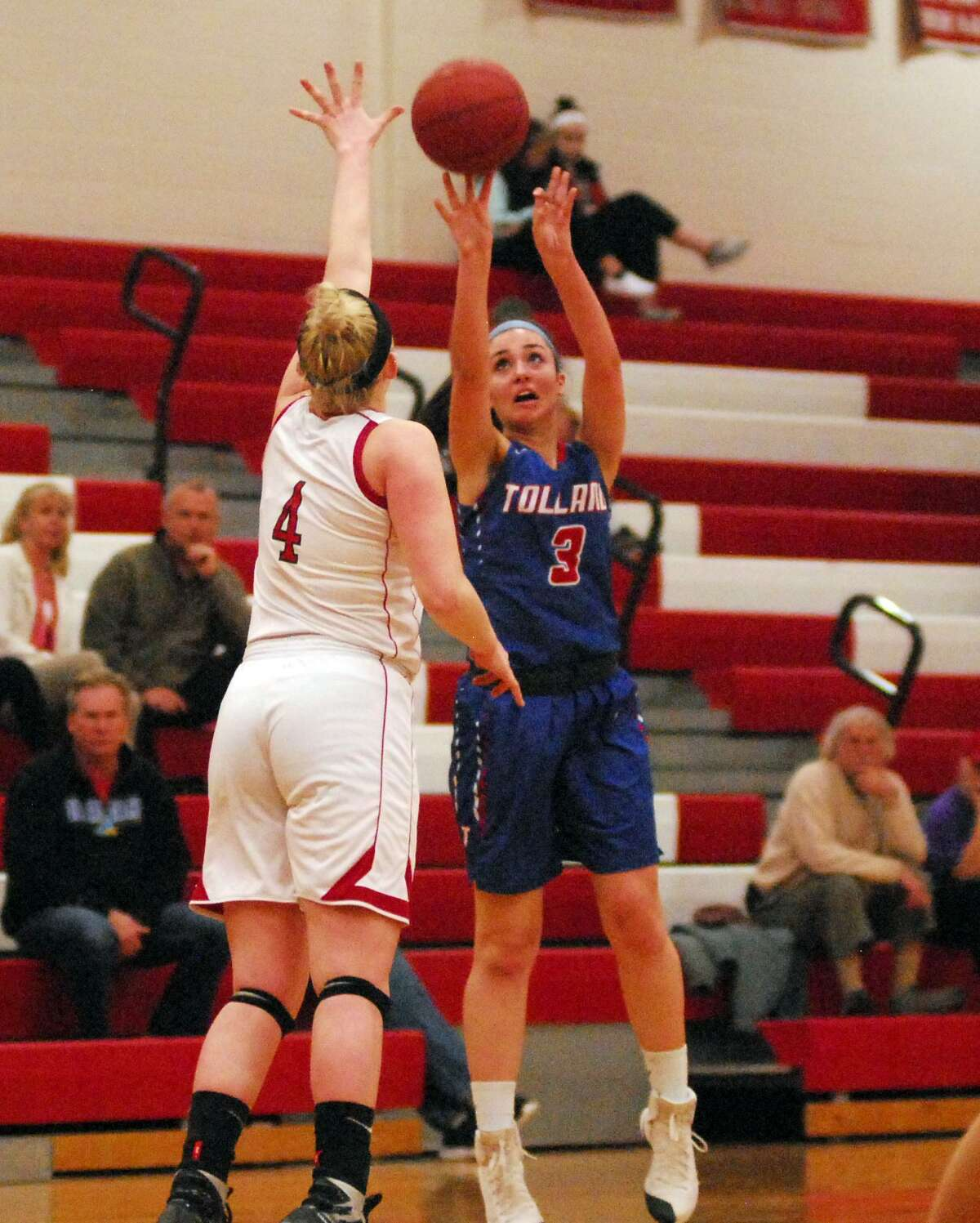 Tolland's Sophia Webster shoots over Pomperaug's Karli Opalka during a Class L first round game Tuesday.