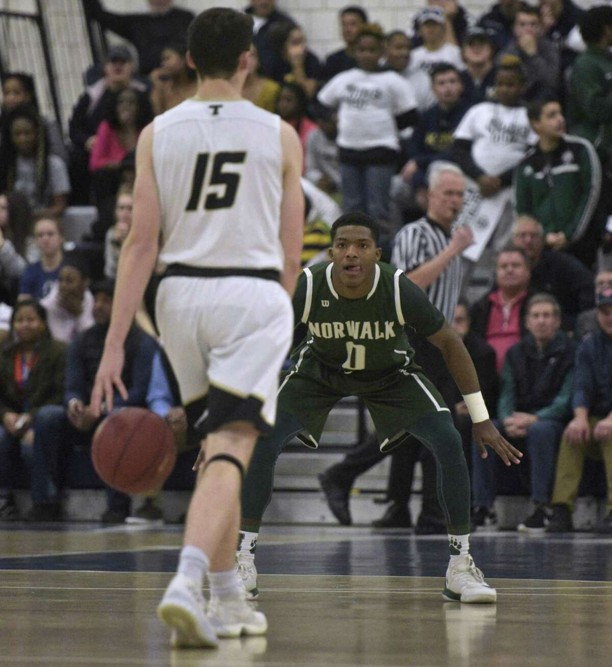 Norwalk's Tyrique Langley (0) defends Trumbull's Chris Brown (15) as he brings the ball up-court in the boys FCIAC basketball semifinal game between Norwalk and Trumbull high schools, at Wilton High School, in Wilton, Conn. Tuesday, February 27, 2018.