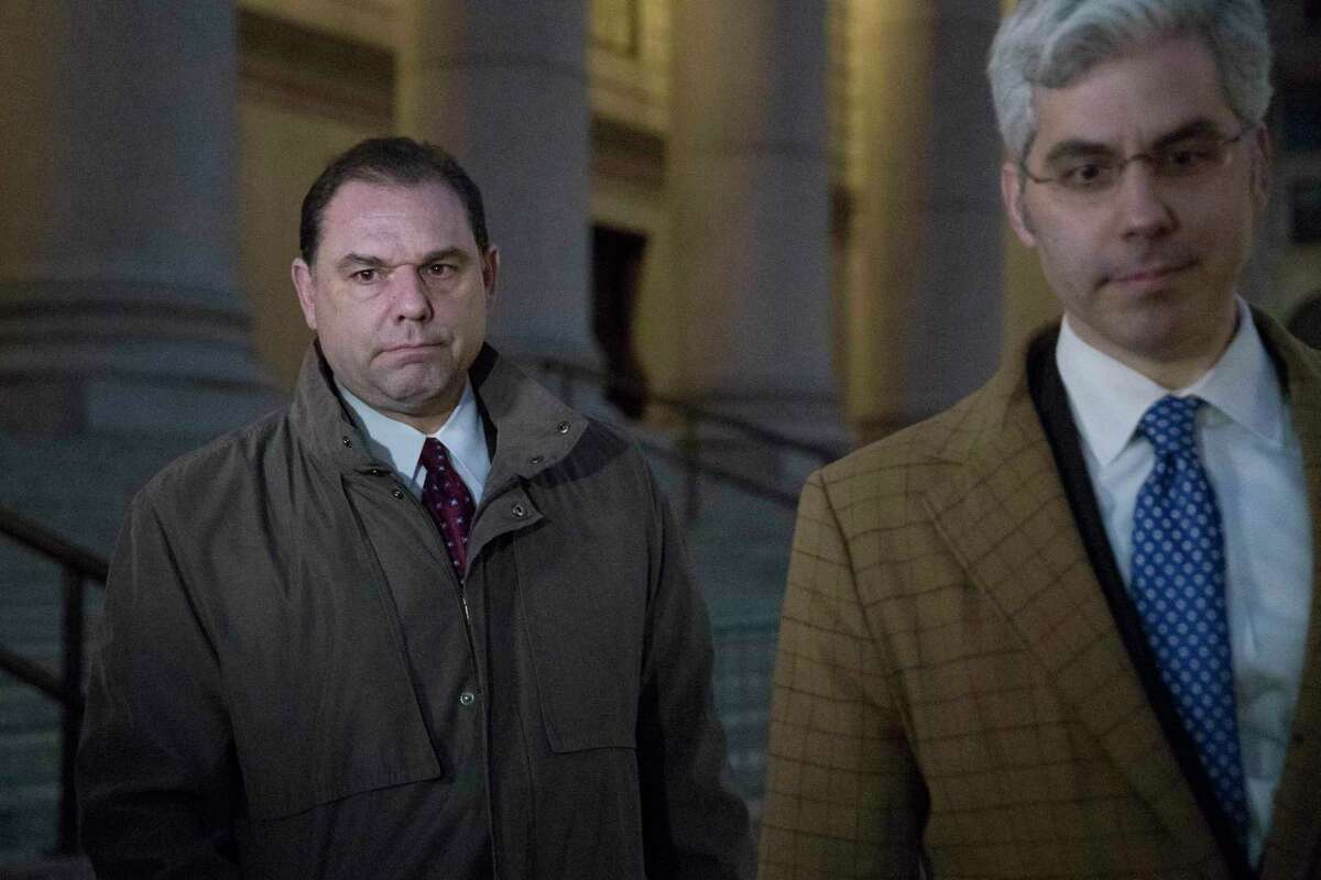 """Joseph Percoco, left, one of Gov, Andrew Cuomo's former executive deputy secretary, leaves U.S. District court with one of his attorneys, Tuesday, Feb. 27, 2018, in New York. Percoco proved his guilt by repeatedly quoting from the mob drama """"The Sopranos"""" as he described bribes he was receiving from three businessmen, a prosecutor told jurors as closing arguments began Tuesday. (AP Photo/Mary Altaffer)"""