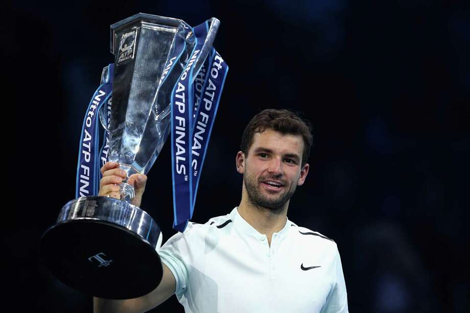 LONDON, ENGLAND - NOVEMBER 19:  Grigor Dimitrov of Bulgaria lifts the trophy as he celebrates victory following the singles final against David Goffin of Belgium during day eight of the 2017 Nitto ATP World Tour Finals at O2 Arena on November 19, 2017 in London, England.  (Photo by Julian Finney/Getty Images) ORG XMIT: 775054395 Photo: Julian Finney / 2017 Getty Images