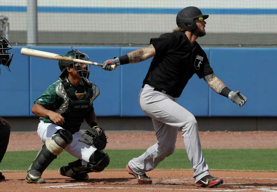 Major League Baseball free agent Jarrod Saltalamacchia bats in front of East Japan Railway Company catcher Watanabe during a scrimmage game Tuesday, Feb. 27, 2018, in Bradenton, Fla. (AP Photo/Chris O'Meara) Photo: Chris O'Meara / Copyright 2018 The Associated Press. All rights reserved.