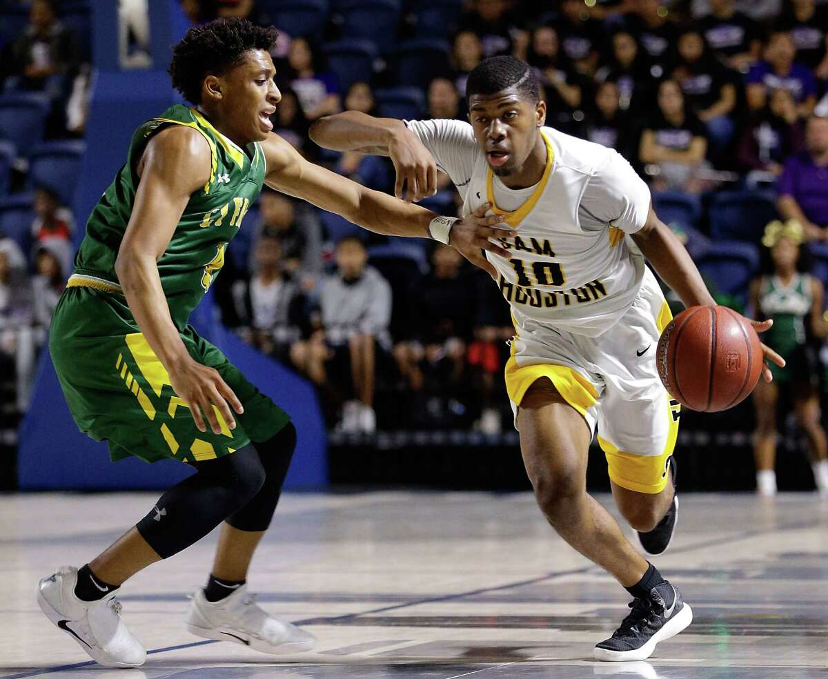 CLASS 6A: Sam Houston 65, Cy Falls 64 (2OT) Sam Houston's Chris Green drives around Cy Falls' Austin Guillory during the 2nd half of their regional quarterfinal game at Delmar Fieldhouse Feb. 27, 2018 in Houston, TX. (Michael Wyke / For the Chronicle)