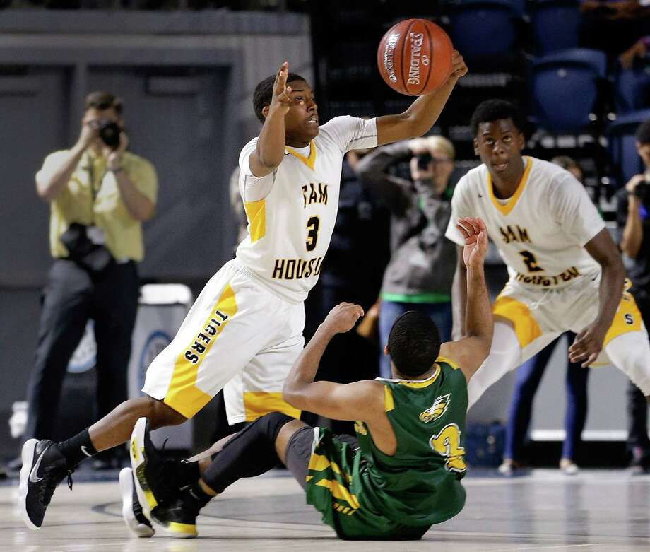 Sam Houston's Torron Mingo comes up with the ball after Cy Fall's Trajan Wesley falls and loses control during the 2nd overtime, effectively ending their regional quarterfinal game at Delmar Fieldhouse Feb. 27, 2018 in Houston, TX. (Michael Wyke / For the  Chronicle) Photo: Michael Wyke, For The Chronicle / © 2018 Houston Chronicle