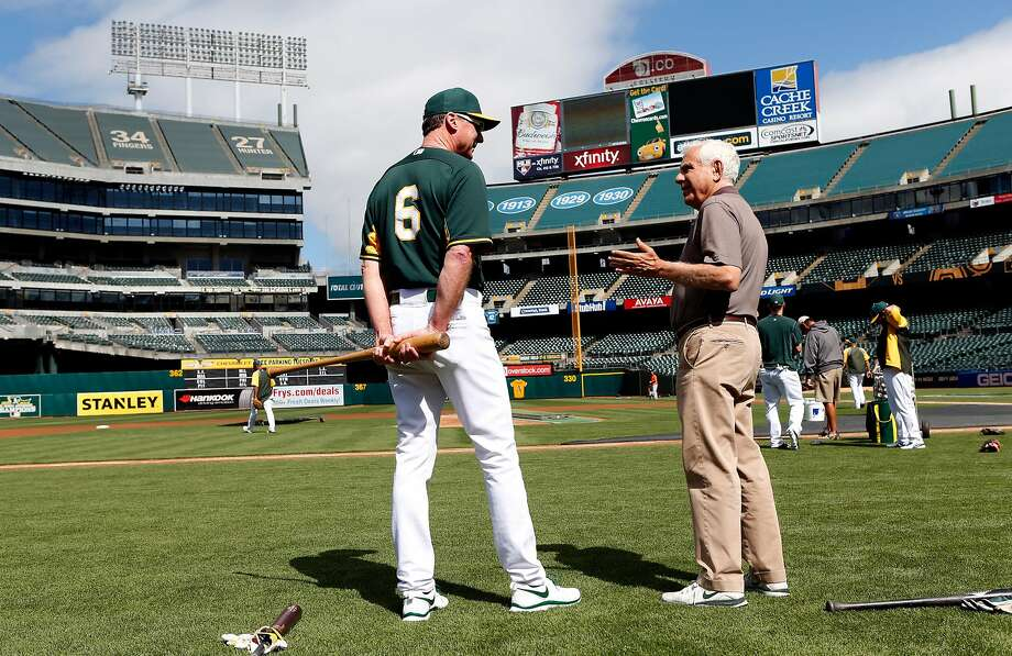 Former Oakland Athletics' owner Lew Wolff chats with manager Bob Melvin before the A's play the Houston Astros in 2014. Photo: Scott Strazzante, The Chronicle