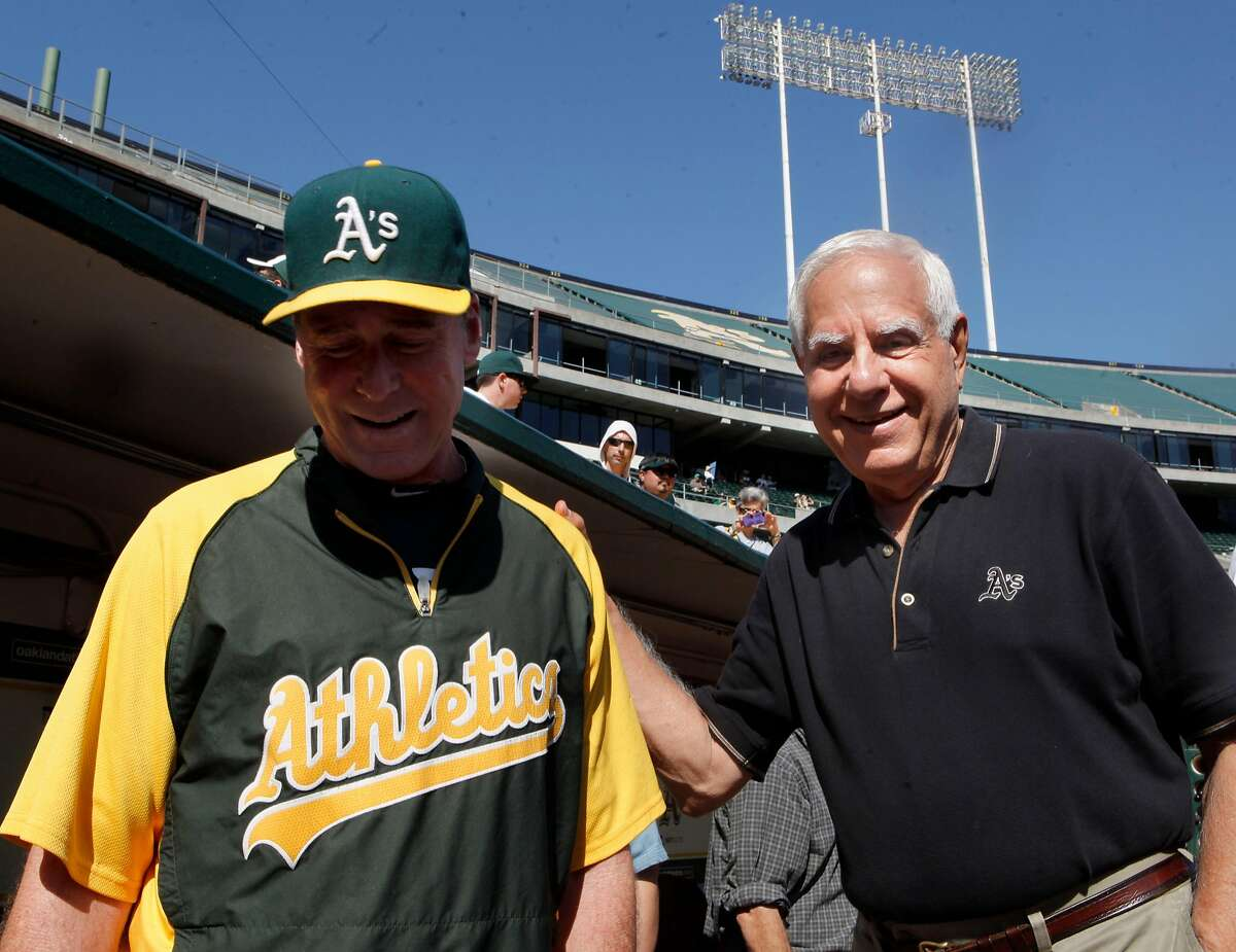 Oakland A's manager Bob Melvin, left, and former owner, Lew Wolff hang out near the dugout before the start of a game in 2012. Wolff isnow owner emeritus of the A's.