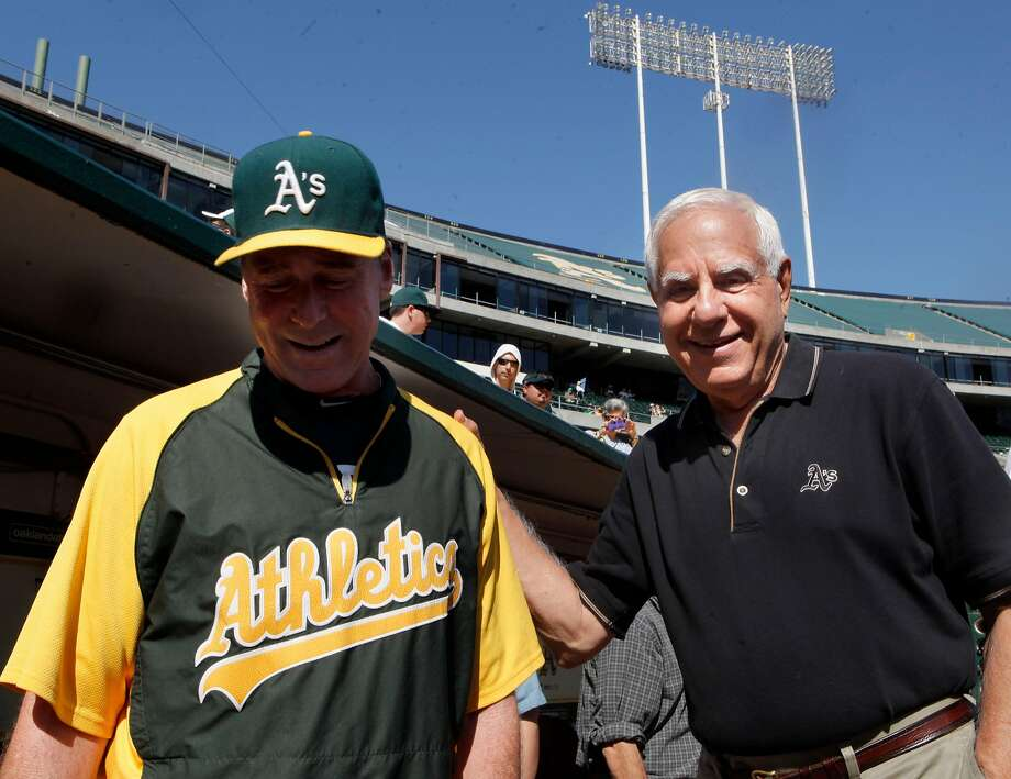 Oakland A's manager Bob Melvin, left, and former owner, Lew Wolff hang out near the dugout before the start of a game in 2012. Wolff is now owner emeritus of the A's. Photo: Michael Macor, The Chronicle