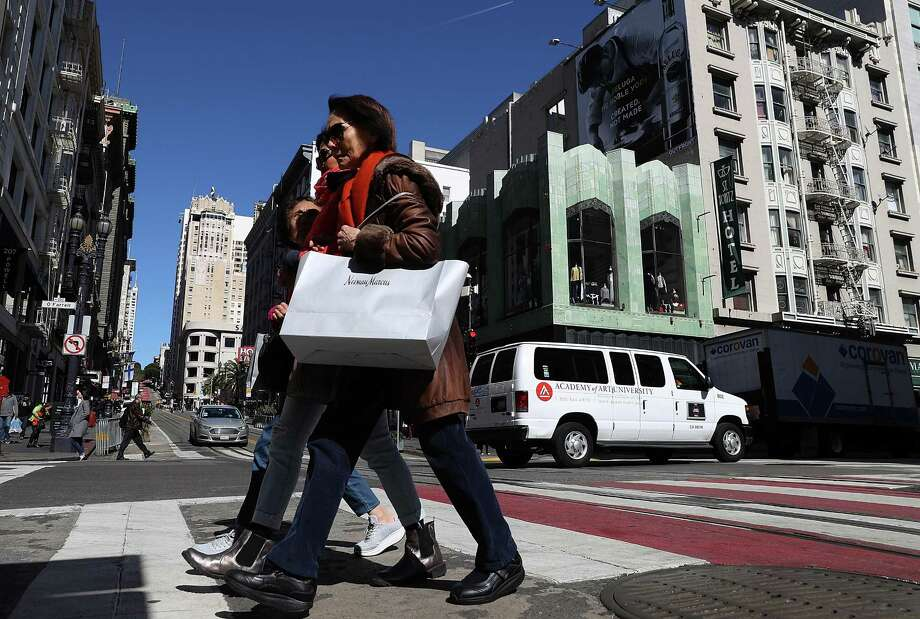A shopper carries a shopping bag while walking in the Union Square district in San Francisco. Photo: Justin Sullivan / Justin Sullivan / Getty Images / 2018 Getty Images