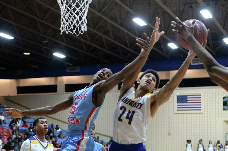 Kylon Bryant (15) of Madison and Vernon Harrell (24) of Elkins reach for a rebound during the fourth quarter of a boys 5A Region III quarterfinal playoff game between the Elkins Knights and the Madison Marlins on Tuesday, February 27, 2018 at Wheeler Field House, Sugar Land, TX. Photo: Craig Moseley, Houston Chronicle / ©2018 Houston Chronicle