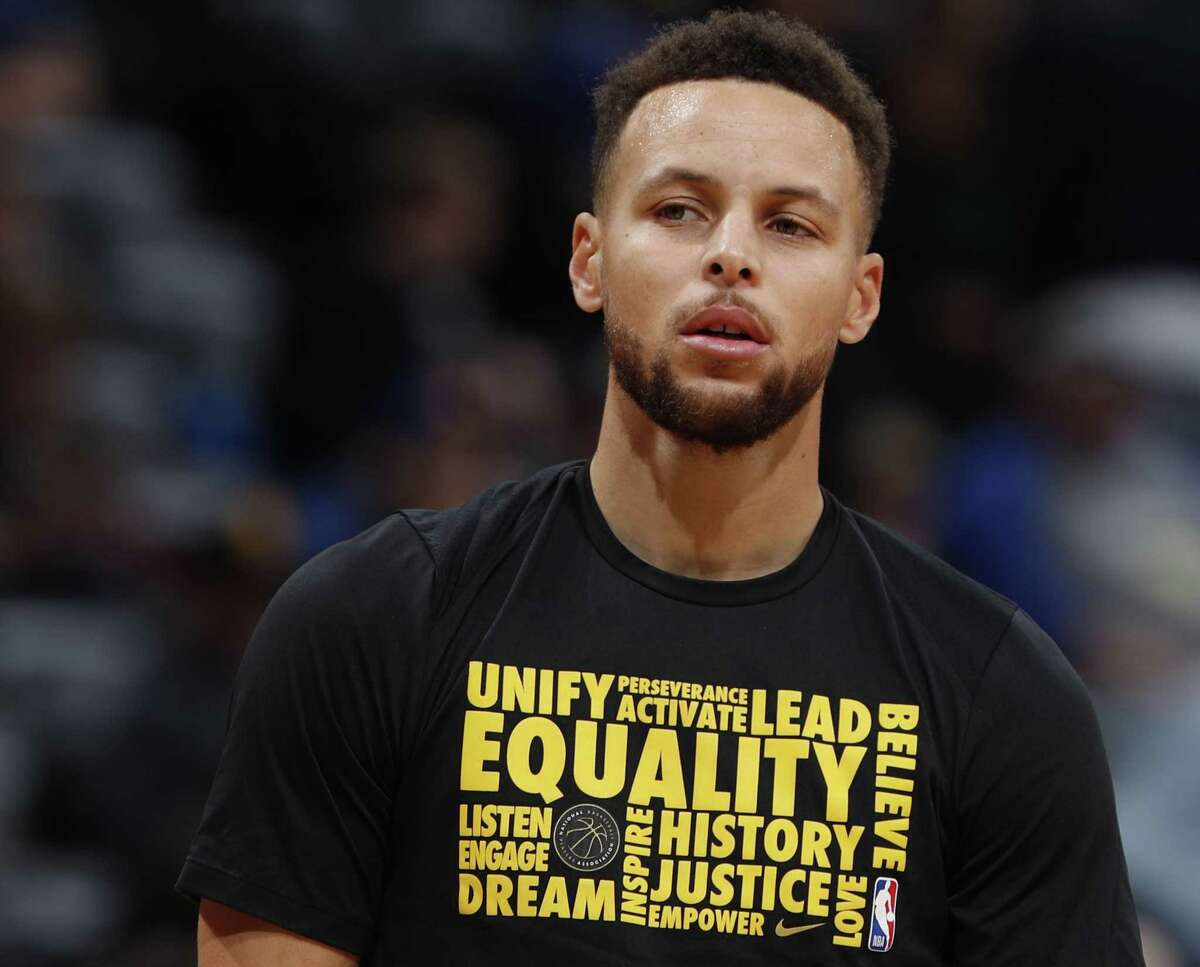 Golden State Warriors guard Stephen Curry (30) in the first half of an NBA basketball game Saturday, Feb. 3, 2018, in Denver. During Black History Month many NBA teams wear t-shirts and participate in events honoring African American histor.