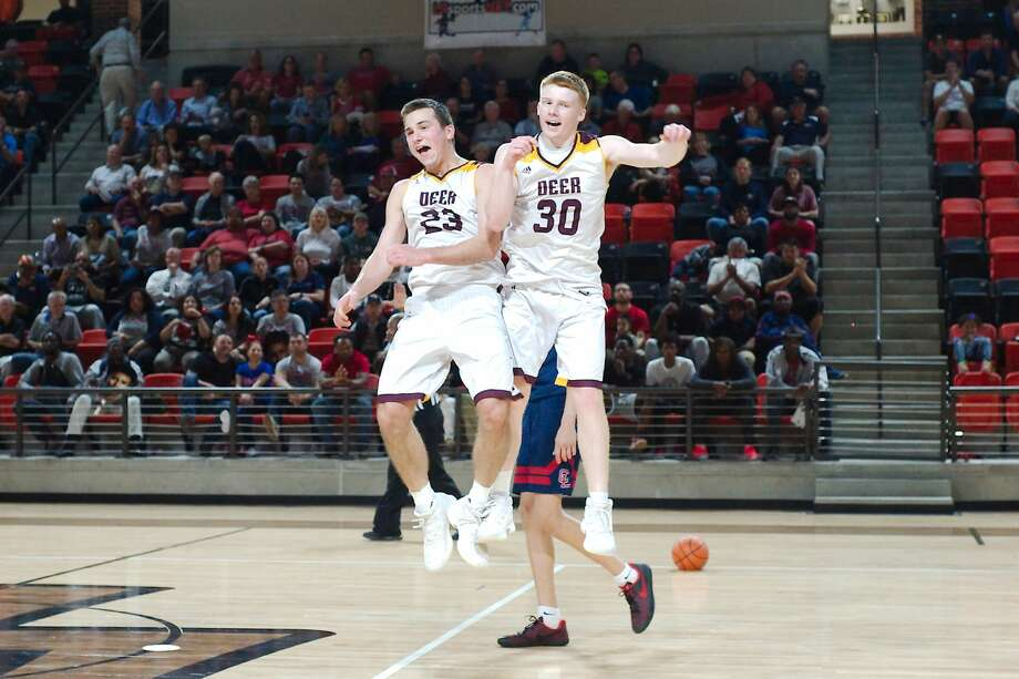 Deer Park's Zach Walker (23) and Deer Park's Cade Parham (30) celebrate after defeating Clear Lake the boys basketball regional quarterfinal playoff Tuesday, Feb. 27 at La Porte High School. Photo: Kirk Sides / Houston Chronicle