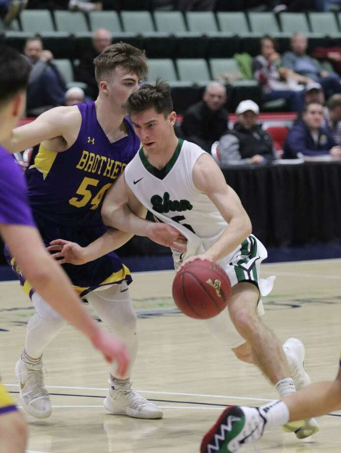 Shen's Chris Hulbert works to get around CBA's Andrew Signor during the Section II Class AA boys' basketball semifinal at the Cool Insuring Arena in Glens Falls, NY Tuesday, Feb. 27, 2018. (Ed Burke-Special to The Times Union)